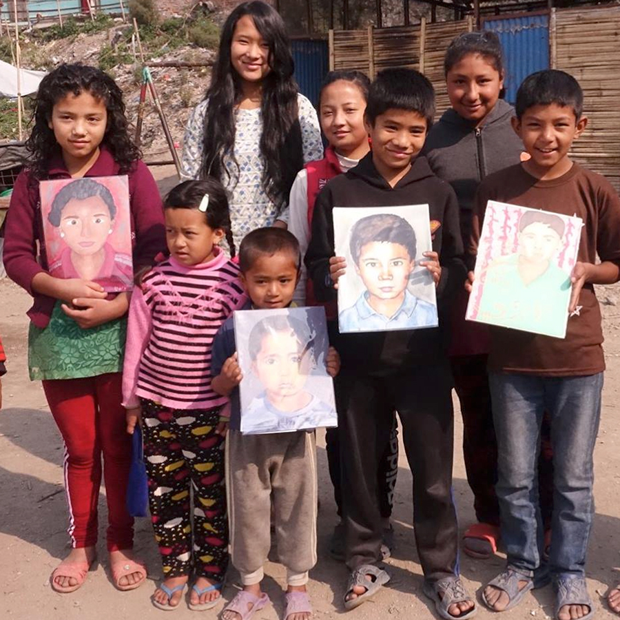 Creating portraits for children living in Nepal.